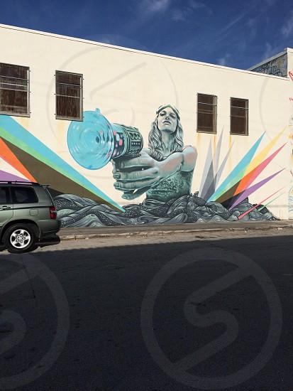 female holding gun graffiti art photo