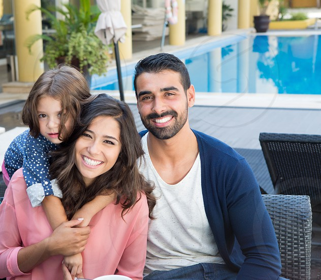 couple family child kid latin hispanic hotel pool photo