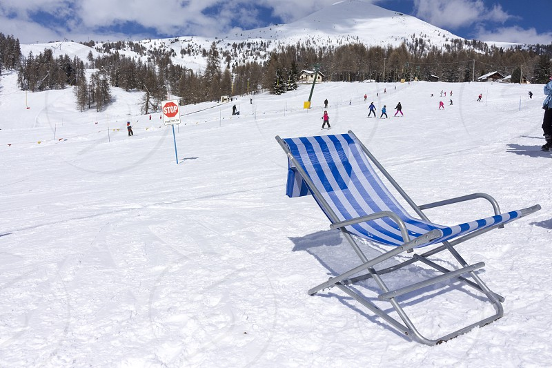 close-up of deck chair on a ski slope photo