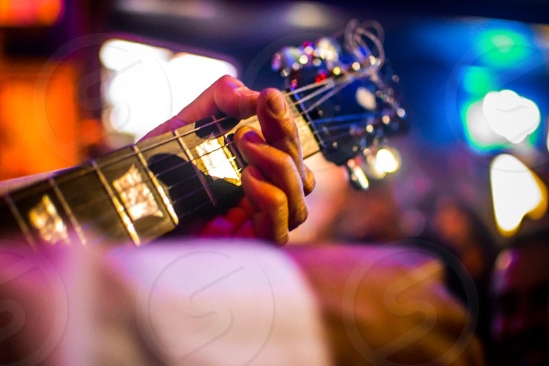 a view of guitar and shot photo