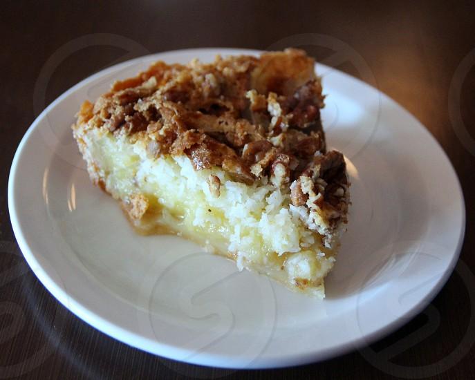Pecan coconut pie on white plate photo