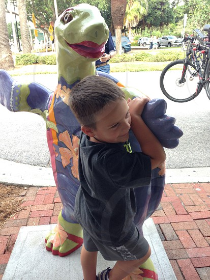 Boy and giant  turtle  photo