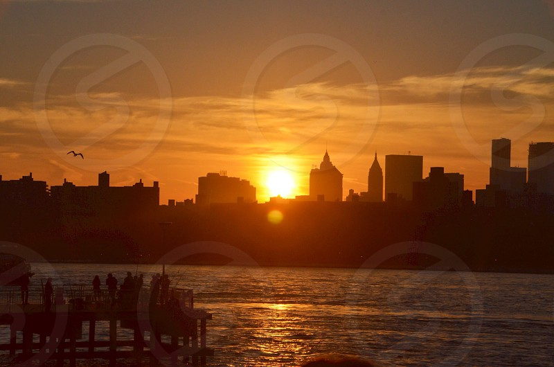 sunset behind city scape photo