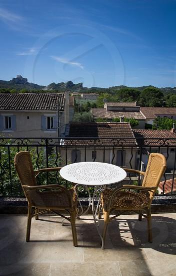 sunny outdoor hotel patio provence france south balcony  photo