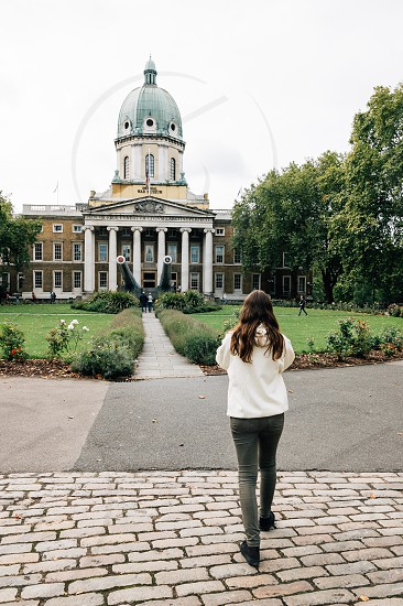 Imperial War Museum. Include all conflicts in which British or Commonwealth forces have been involved since 1914. Young woman walking into the garden of Museum photo