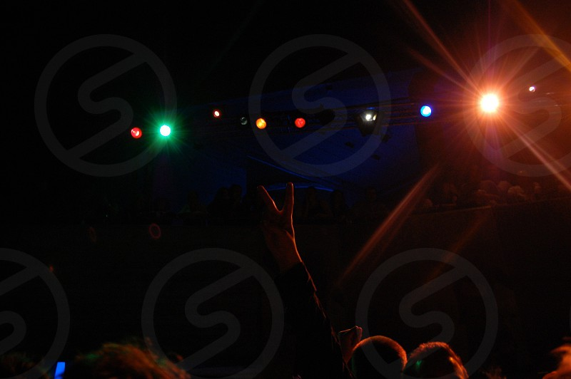 photography of group of people in concert photo
