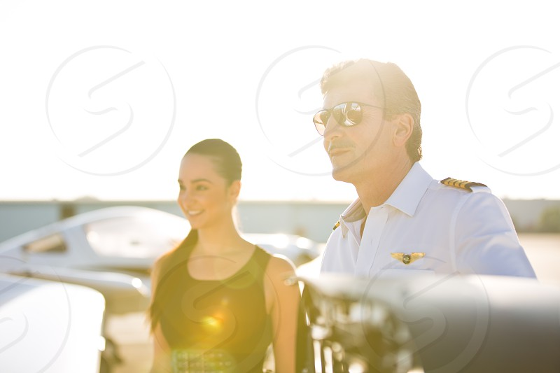Pilot and his wealthy client at Sunset photo