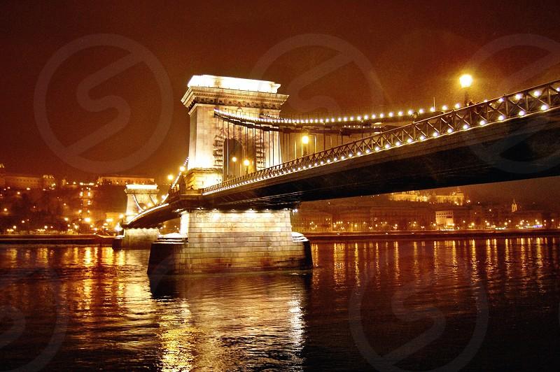 view of gray and yellow bridge at night photo