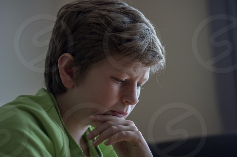 Portrait of boy looking focused photo