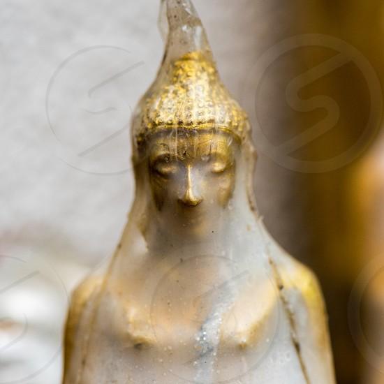 Closeup of Buddha figure wrapped in plastic. photo
