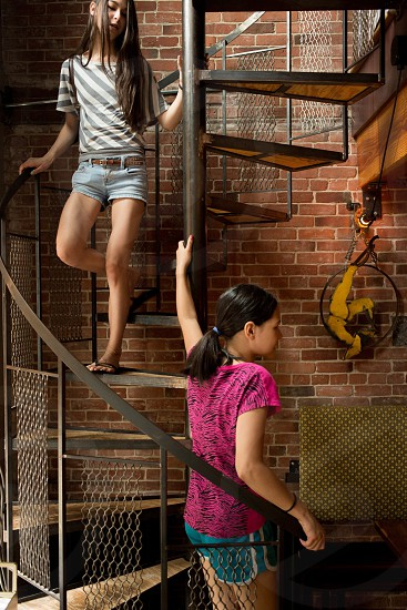 girl wearing gray and white stripe blouse at the spiral staircase photo