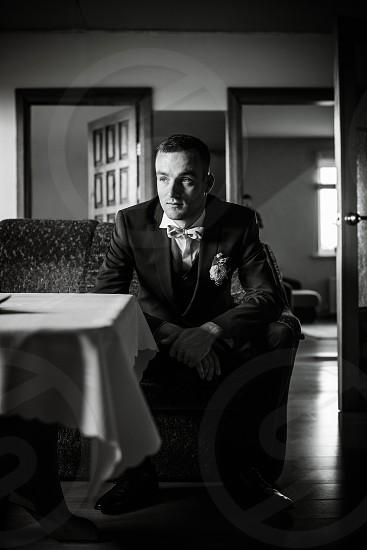 Groom alone before wedding photo