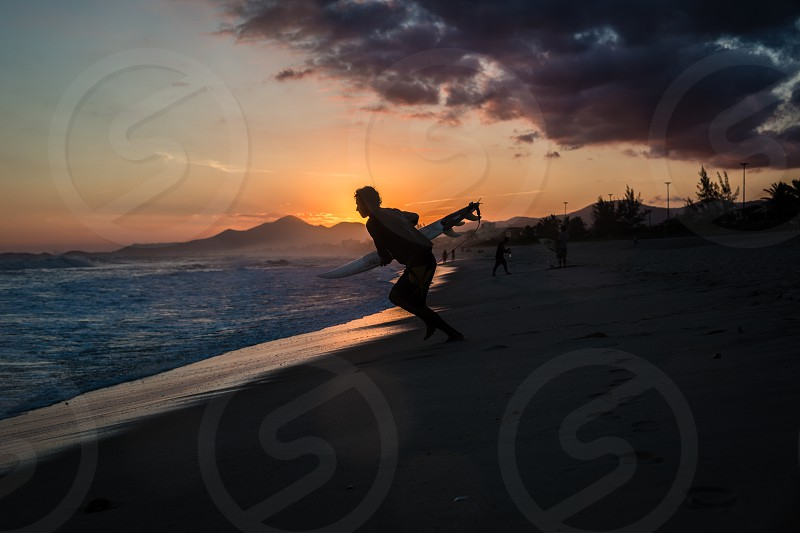A surfer running to your passion: the sea the sport the life. photo