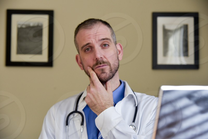 doctor wearing his stethoscope photo photo