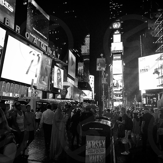 grayscale photo of people in front of Broadway building in New York photo