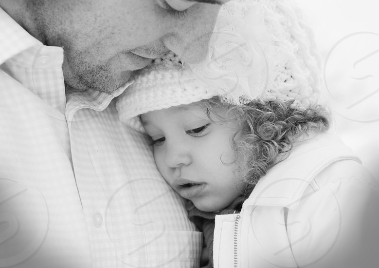 baby lying on chest of man photo