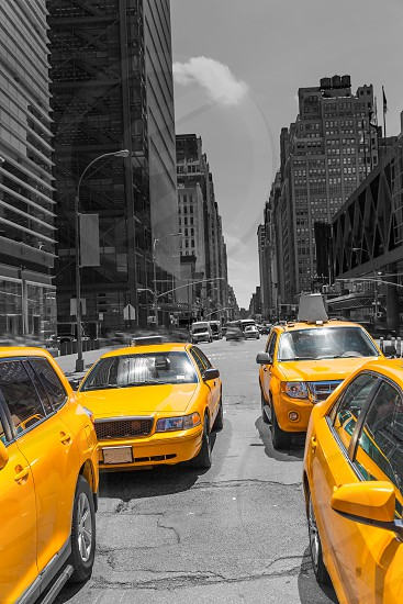 Times Square New York yellow cab taxi daylight US photo