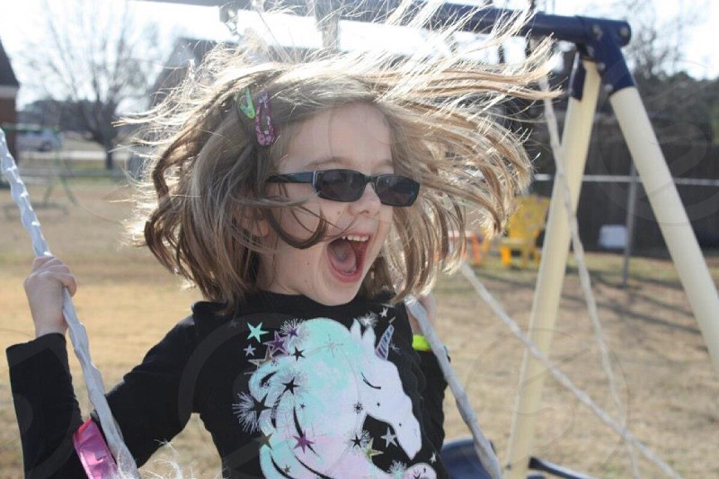 Kid swinging.  photo