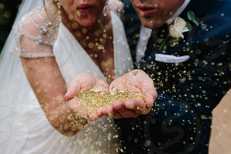 wedding couple glitter confetti blow love lifestyle event special in love vows marriage married just married magic sparkle detail photo