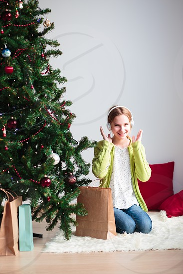 Girl pleasantly surprised at Christmas gift photo