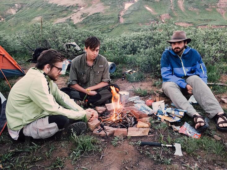 3 men and bonfire photo