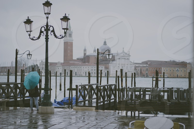 Rain umbrella girl faded venice italy gondole landscape trip sea. photo