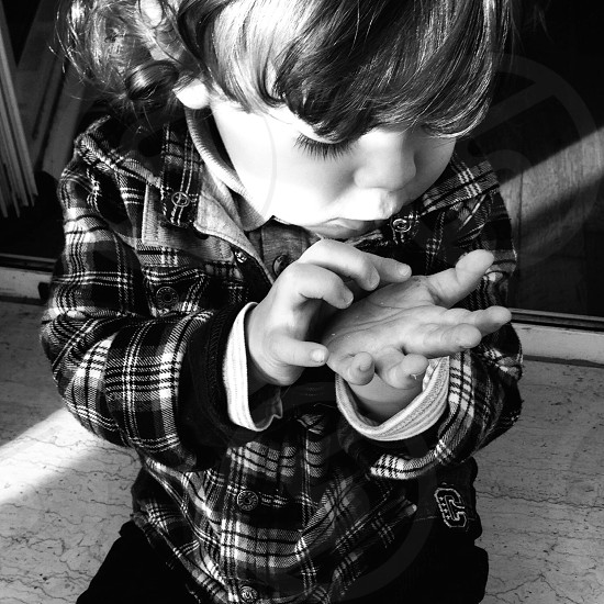 boy in white and black plaid patterned grayscale photography photo