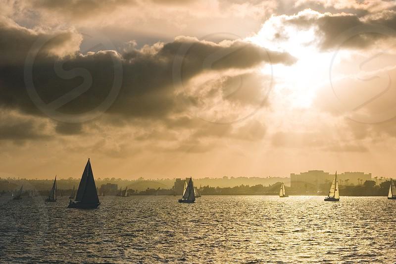 Sailboats Sailing During An Orange Sunset photo
