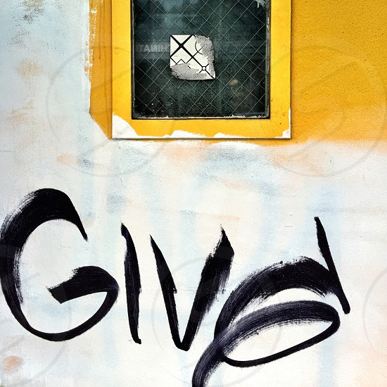 Yellow/white wall windowgraffiti  photo