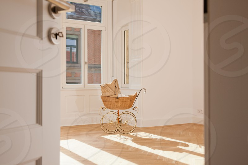 Vintage Buggy in empty apartment photo