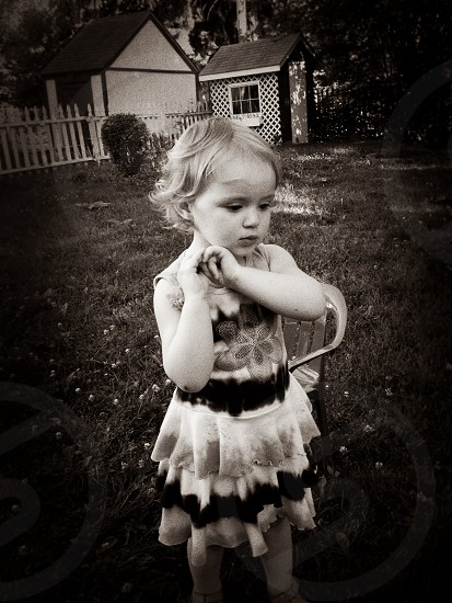 grey scale photography of girl in black and white ruffled tank dress photo