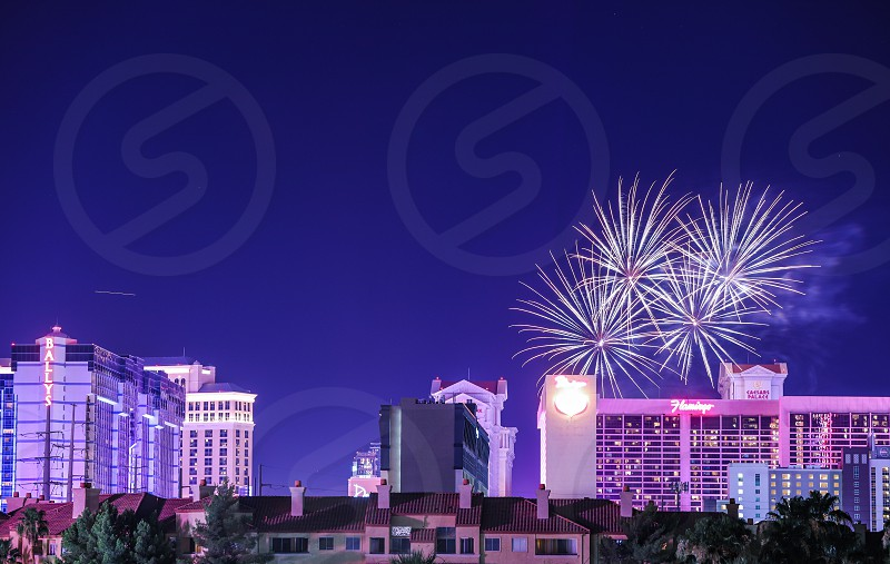 fireworks city night sparkles sparkle celebration holiday festive 4th of July Independence Day New Year's Las Vegas urban buildings scenery scenic long exposure architecture bright photo