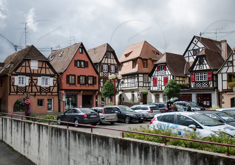 cars parked near houses photo