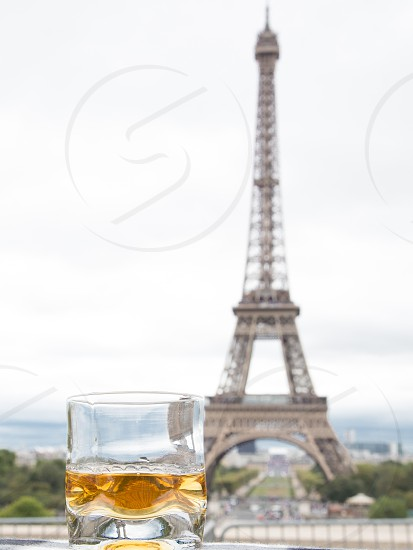 whisky glass in front of Paris landmark photo