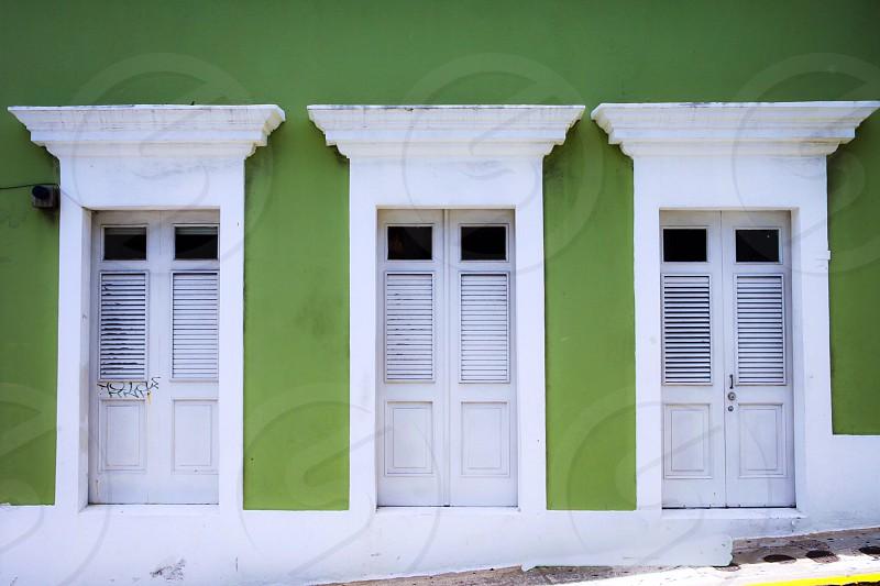 White doors green wall photo