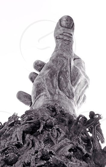 grey concrete hand statue  photo