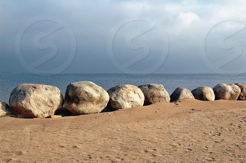 white large rocks near sea photo