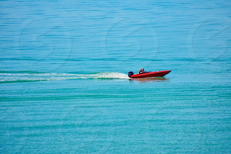 St. Pete Beach Florida. January 25 2019.  Couple having fun in bass boat in Gulf Coast Beaches. photo
