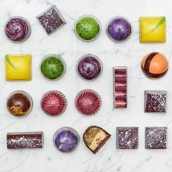 Set of multi-colored sweets tasty isolated on a white marble background photo
