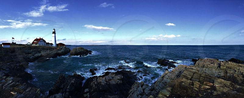 Light house on coastline  photo