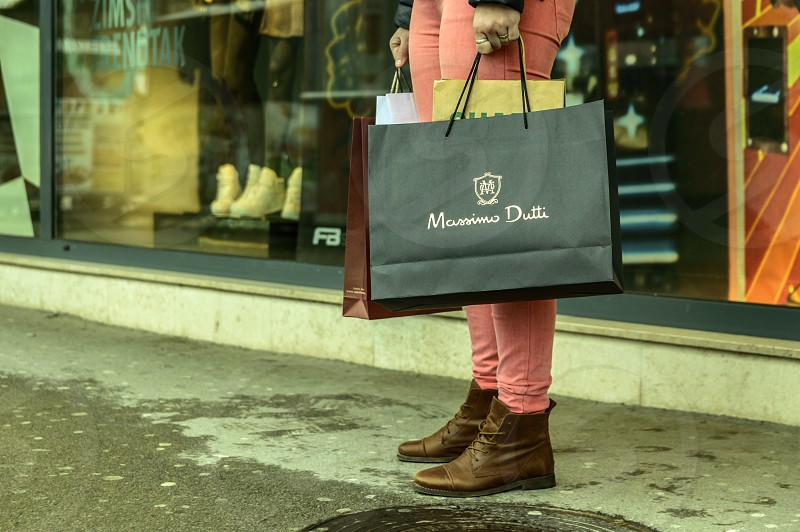 Girl with the shopping bags standing in front of the shop photo