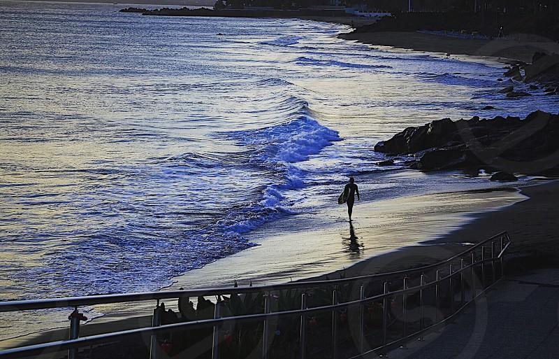 Beach  surfing surfer sea water ocean silhouettes silhouette cliffs nature person sport photo