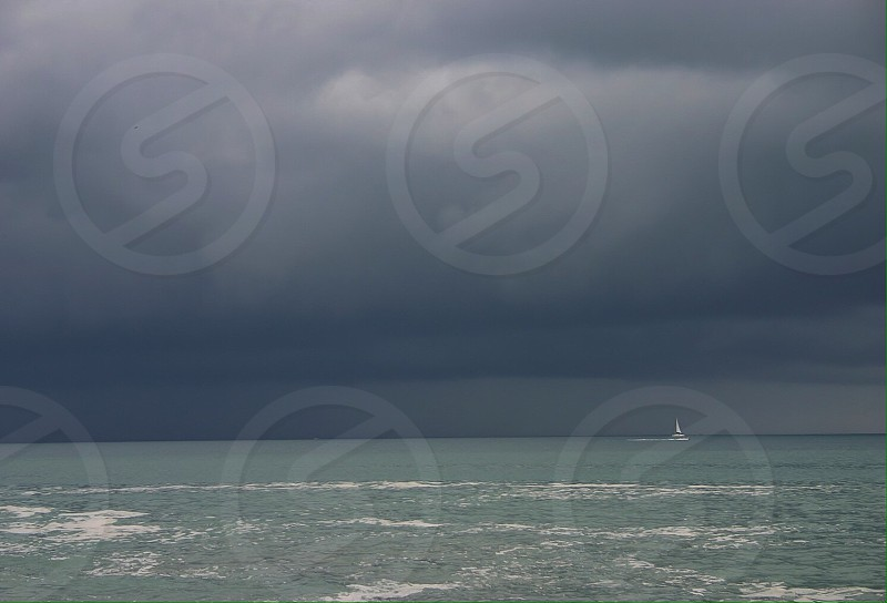 Sailing fast to escape the coming storm photo