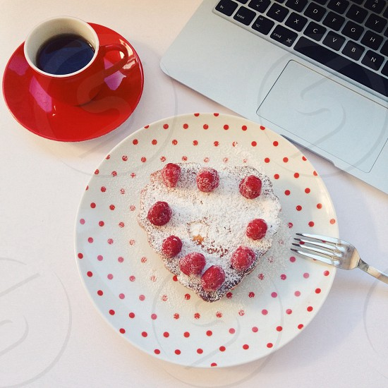 heart pastry with raspberries photo