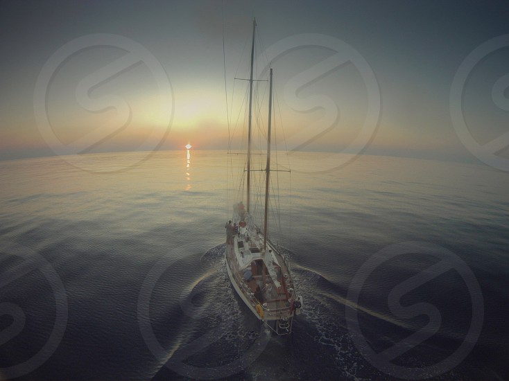 Horizon yacht sailing sunset journey trip adventure forward moving distance long way ocean Atlantic sail boat aerial ketch open space  photo