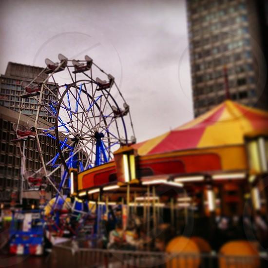 Carnival carousel and ferris wheel in downtown Boston MA. photo
