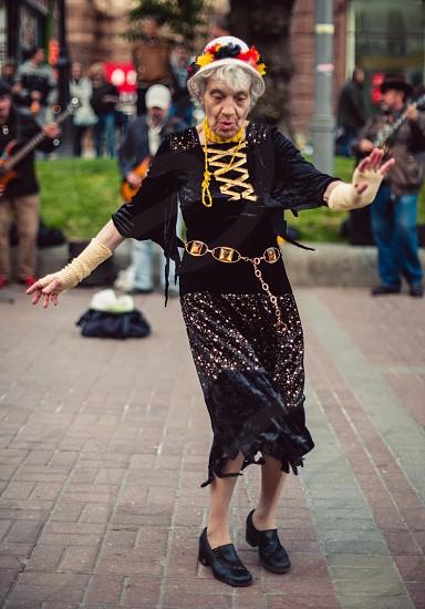 Old woman dancing photo
