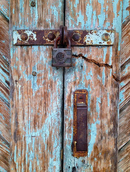 A colorful door detail with rusty lock and handle. photo