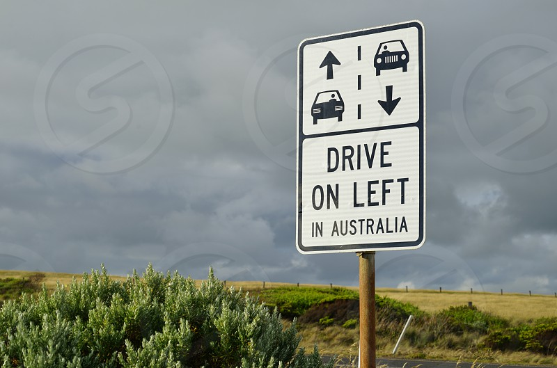 Road sign reminding tourists to drive on the left along the Great Ocean Road - Melbourne Victoria Australia photo