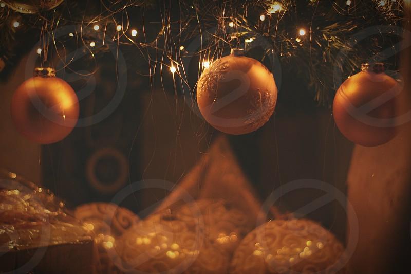 selective focus of three orange baubles photo
